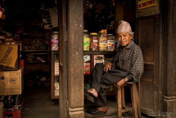 Old man in kandy shop
